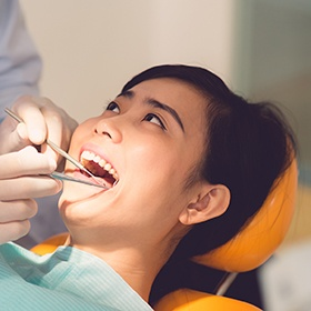 Woman receiving dental checkup