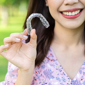 Hand holing set of clear aligners