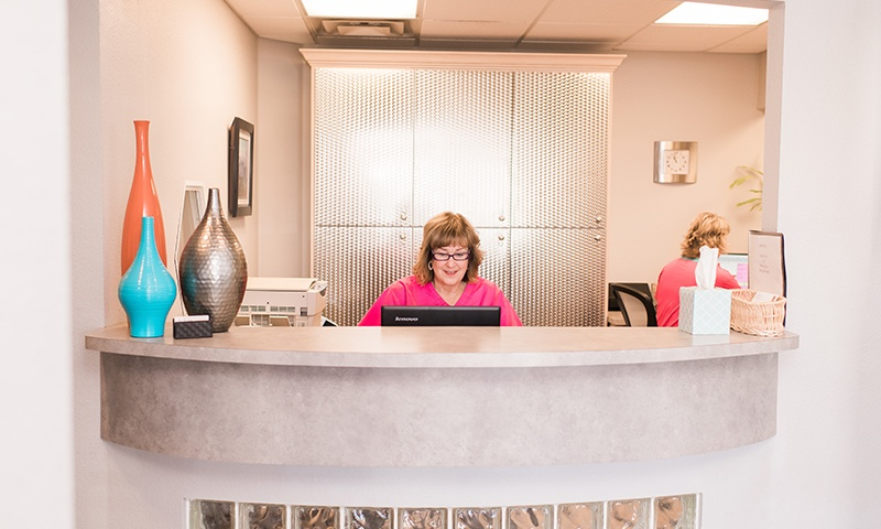 Two women at front reception desk