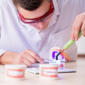 A man working on a mold of veneers