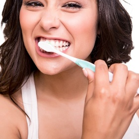 A young woman brushing her teeth