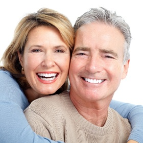 An older woman and man hugging and smiling