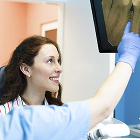 Smiling woman looking at x-rays