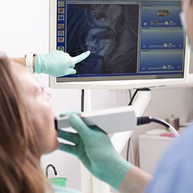 Woman and dentist looking at intraoral photos