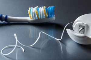 dental floss and brush